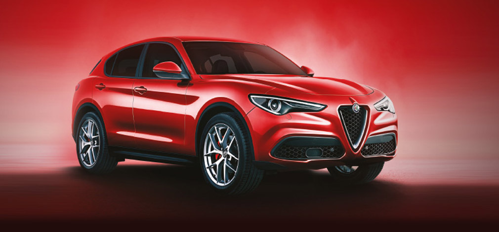 Red Alfa Romeo Stelvio with a red and black backdrop.