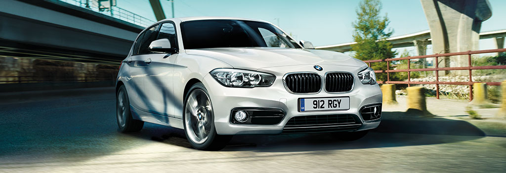 BMW 1 Series driving on road