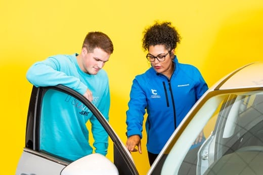 Product consultant showing a customer inside the car