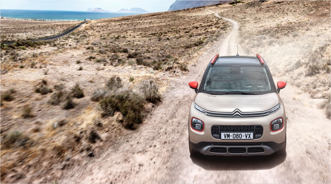 Citroen C3 Aircross driving down a desert road.