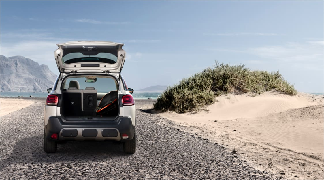 Citroen C3 Aircross on the beach with its boot open.