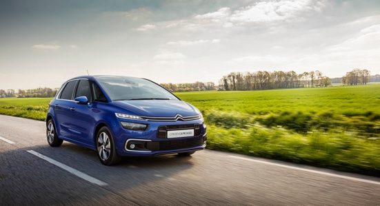 Blue Citroën C4 Picasso on a country road