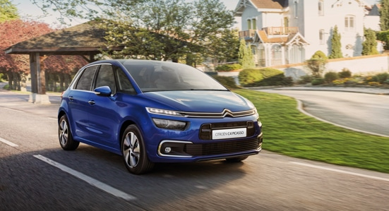 Blue Citroën C4 Picasso driving
