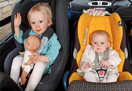 Kids strapped into their car seats