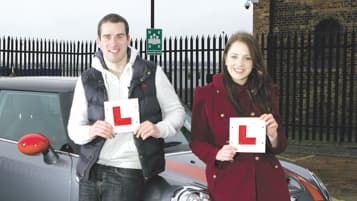 Learner drivers holding learner badges
