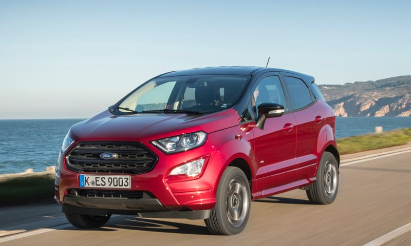 Red Ford Ecosport in Ruby Red driving down the coastal route.