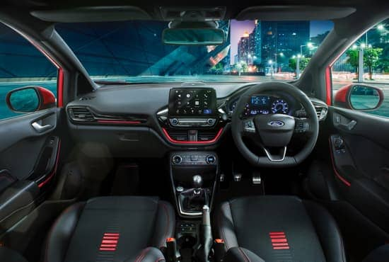 Ford Fiesta Vignale interior at night, in the city.