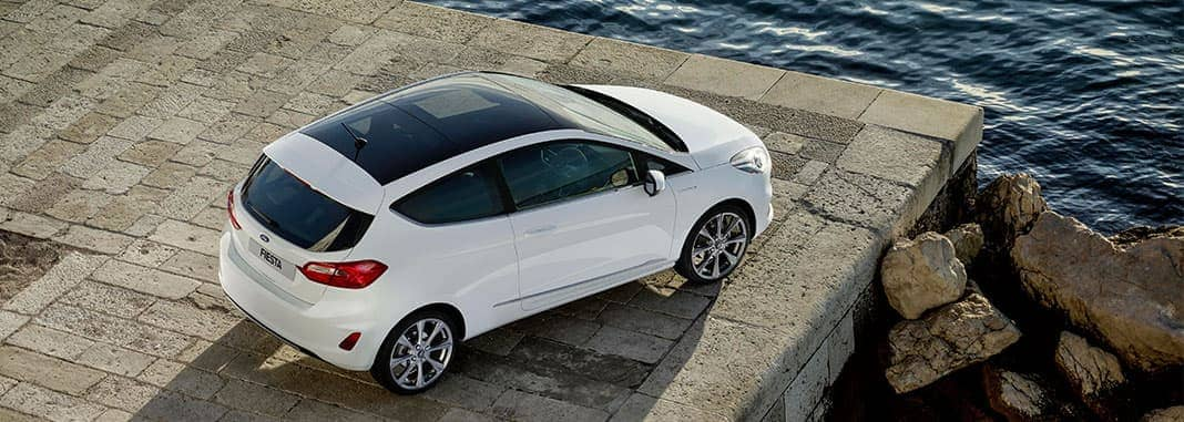 White Ford Fiesta with panoramic roof on edge of a pier