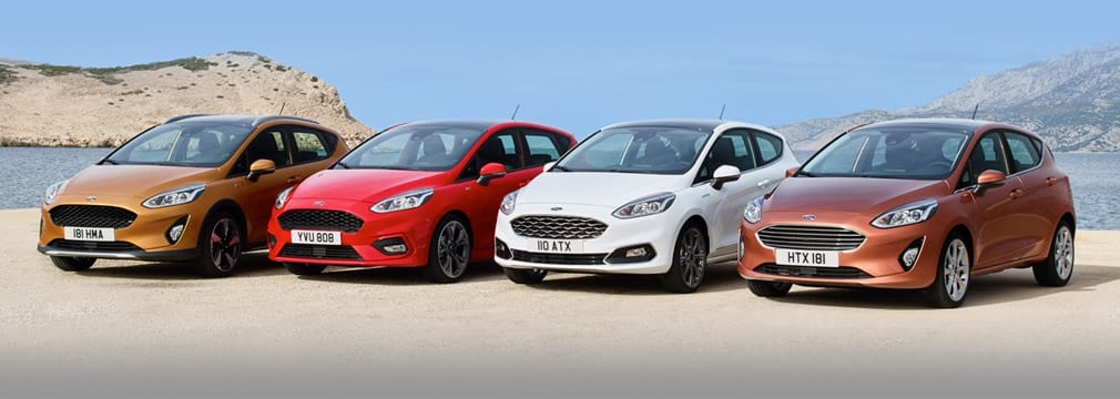 The new Ford Fiesta range lined up scenic mountain backdrop.