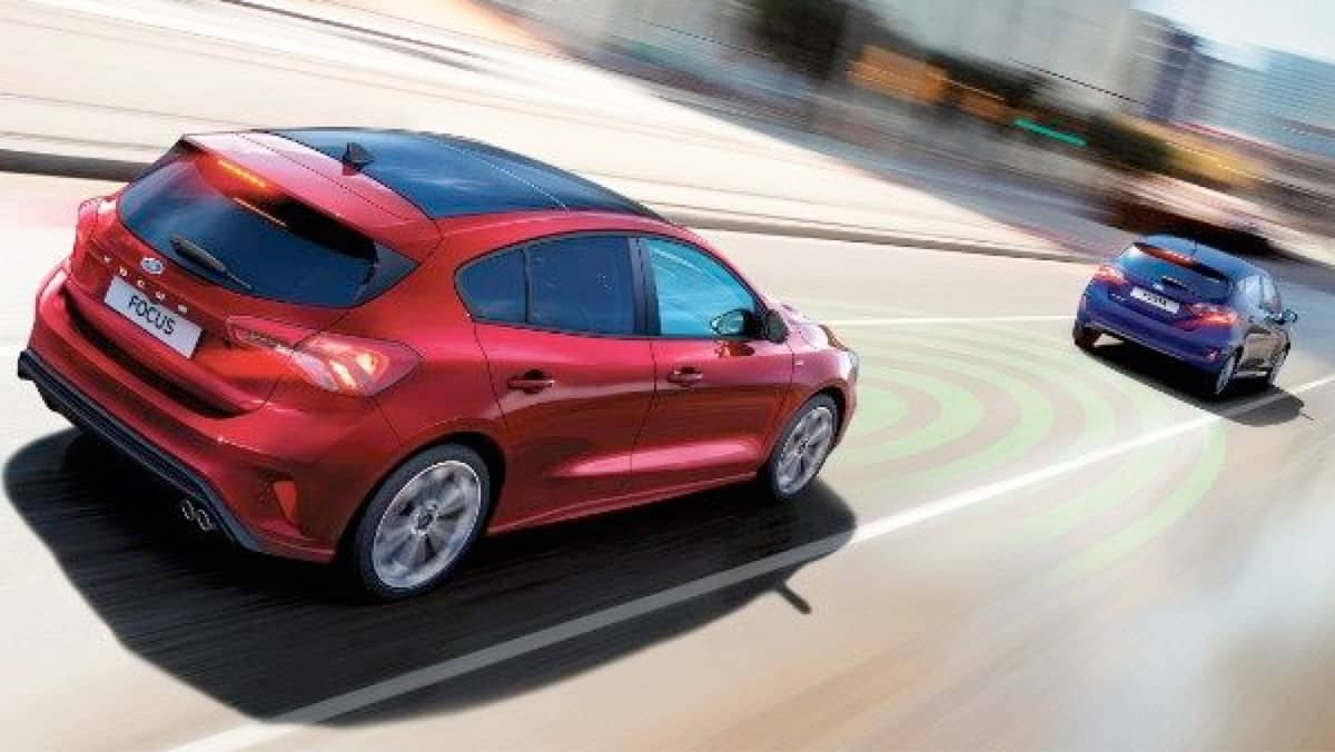 Red and Blue Ford Focus demonstrating Active Braking System