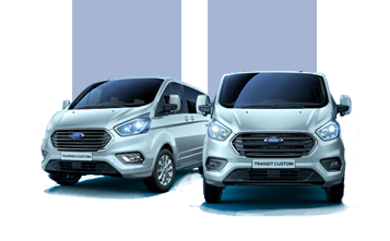 Two Silver Ford Transit models.