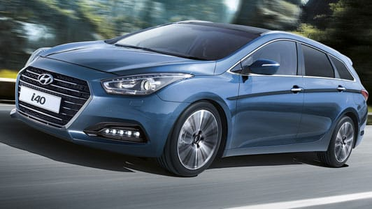Blue Motability Hyundai i40 driving down a country road