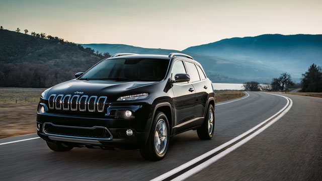 Jeep Cherokee dricing on scenic road