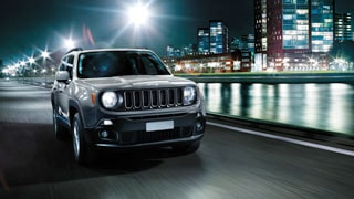 Jeep renegade driving on riverside road