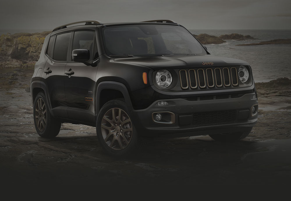 Jeep Renegade 75th Anniversary Edition parked on rocky beach
