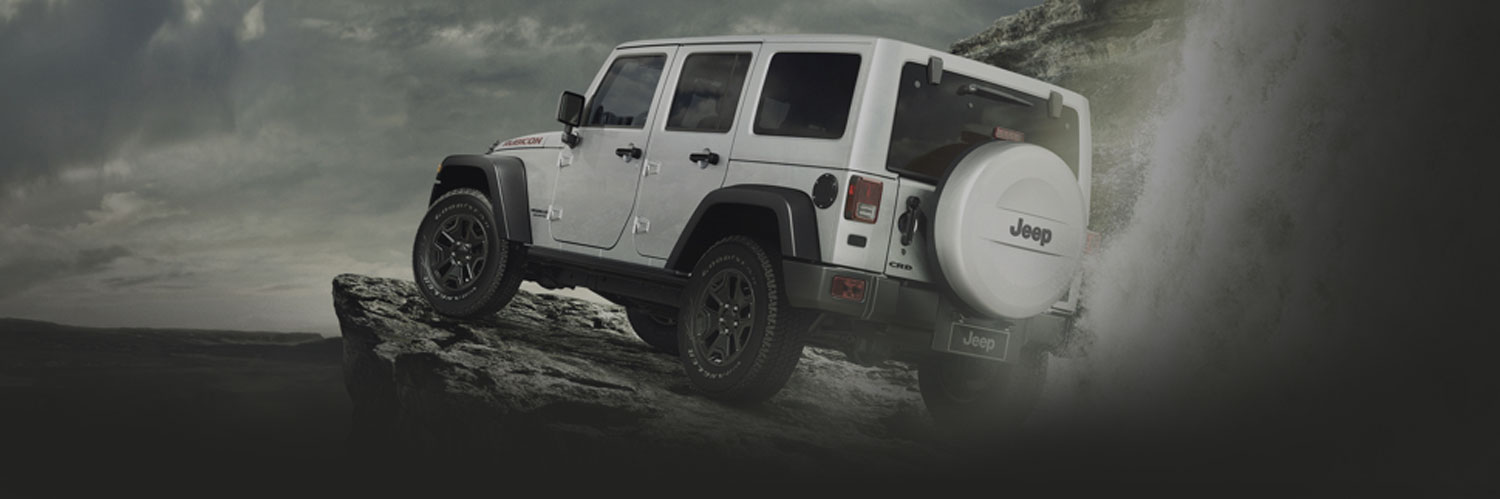 Jeep Wrangler climbing a mountain.