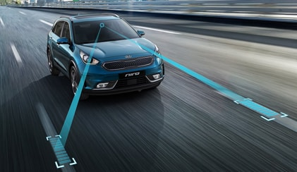 Blue Kia Niro reading lanes