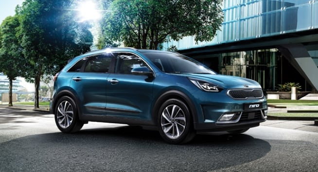 Blue Kia Niro parked in a street