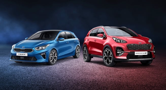 Blue Kia Ceed and Red Kia Sportage in studio.