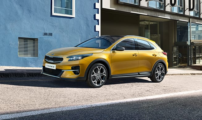 Side view of a yellow Kia XCeed