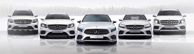 Mercedes-Benz range in snow woodland