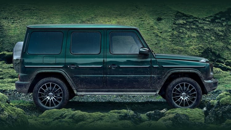Green Mercedes-Benz G-Class model parked on gravel road
