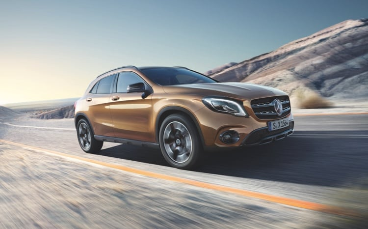 Mercedes-Benz GLA model driving through a country road