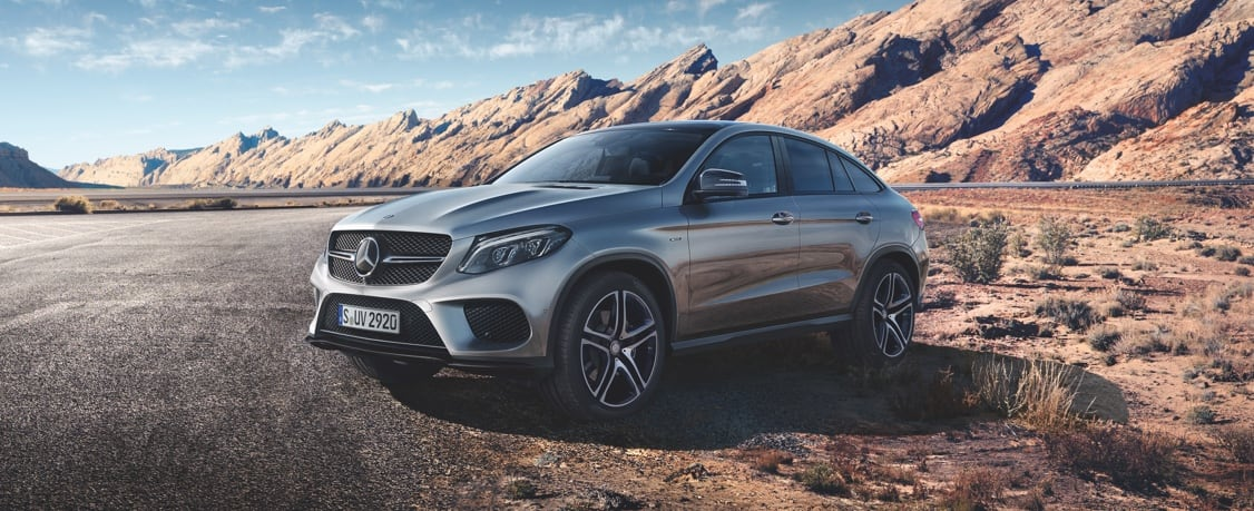 Mercedes-Benz GLE Coupe model parked next to a hilly terrain