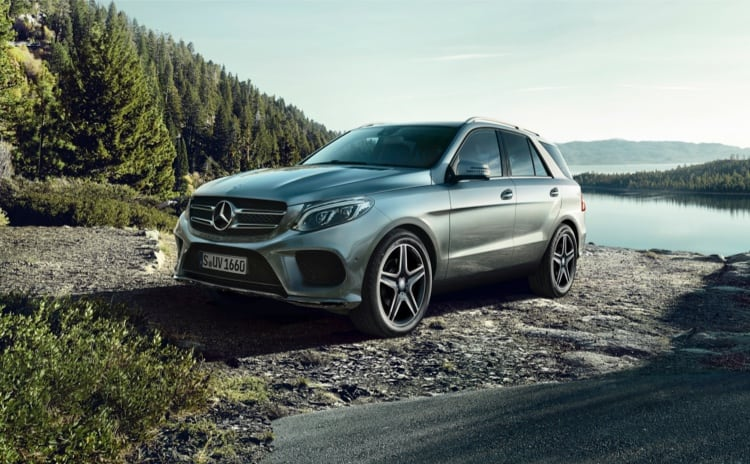 Silver Mercedes-Benz GLE model parked at lake