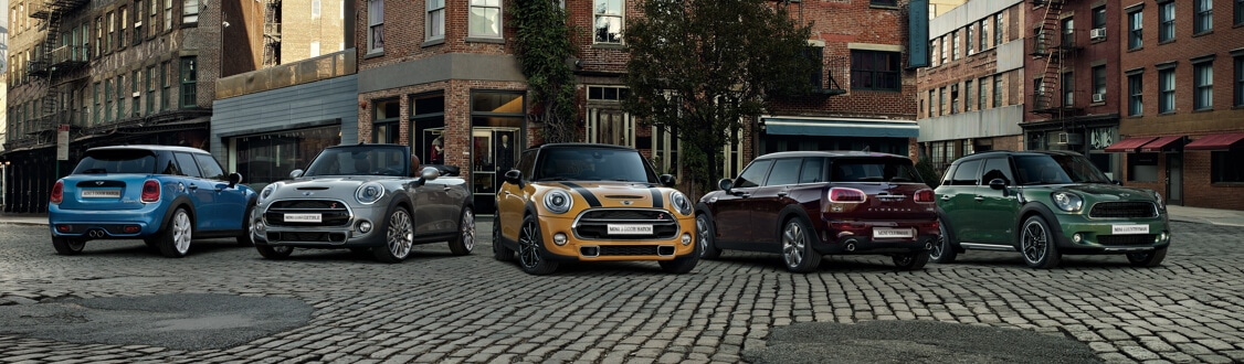 Range of MINI models on city street