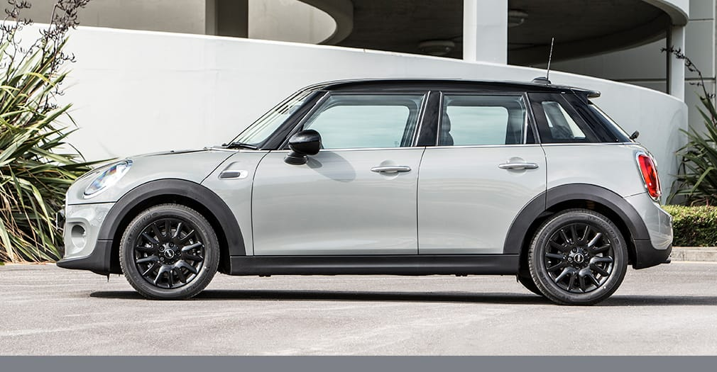 MINI Clubman parked on street, in grey.