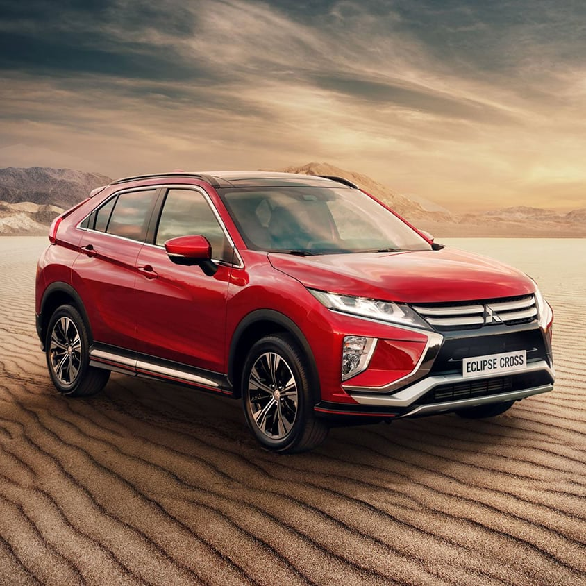 Red Mitsubishi Eclipse Cross in the desert