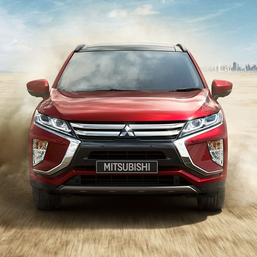 Front view of red Mitsubishi Eclipse Cross driving in the desert