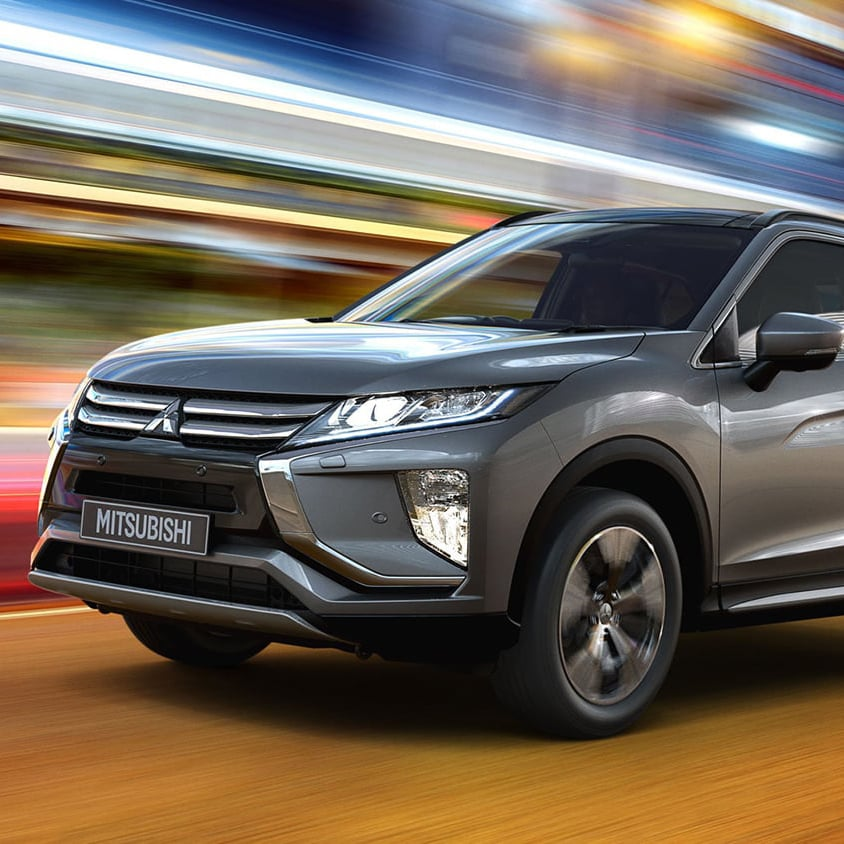 Grey Mitsubishi Eclipse Cross driving on a city road