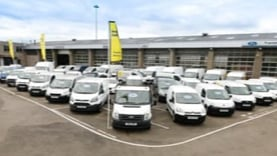 Image of a fleet of vans.