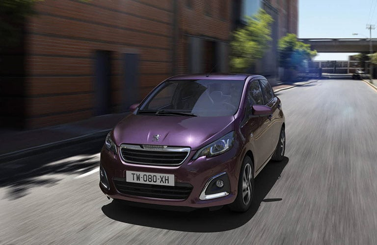 Purple Peugeot 108 in the city