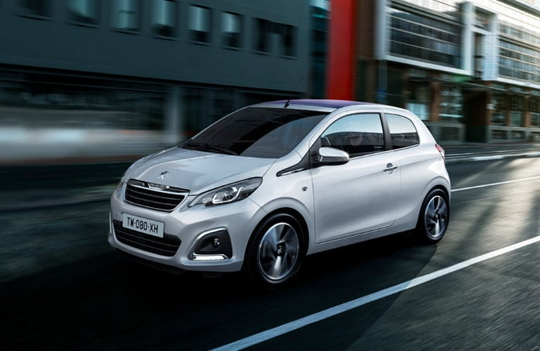Silver Peugeot 108 in the city