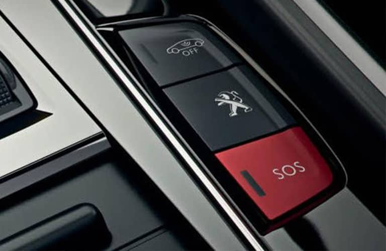 The Peugeot 308's groundbreaking SOS system shown above the rear view mirror.