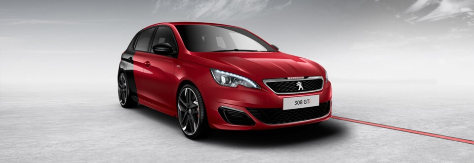 Red and black Peugeot 308 GTi parked on a grey road