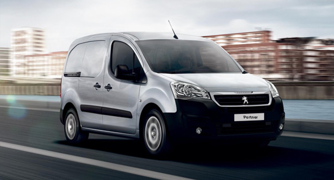 White Peugeot Partner Van.