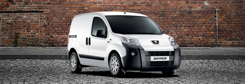 Peugeot Bipper Van infront of a red brick wall