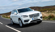 Volvo XC90 in WHite driving on country road