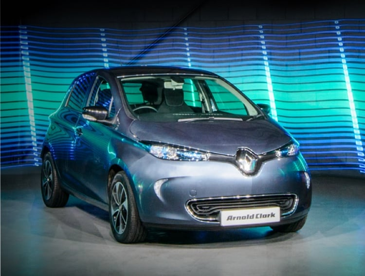 Blue Renault Zoe infront of bright LED lighting