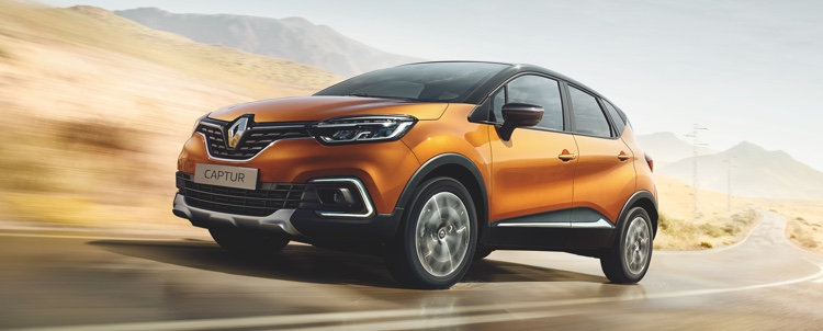 Renault Captur driving on road.