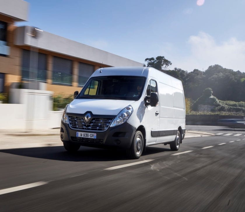 White Renault Master driving on sunny street