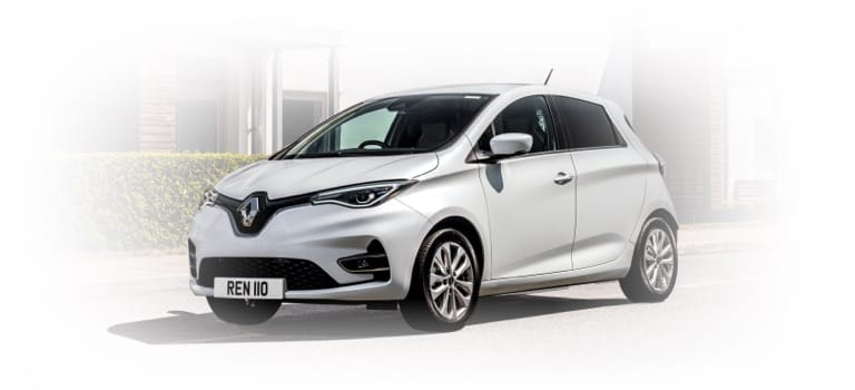 White Renault Zoe charging against white background