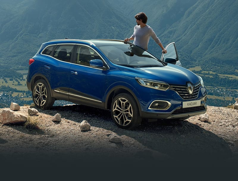 Blue Kadjar on a cliff with a person opening the door.
