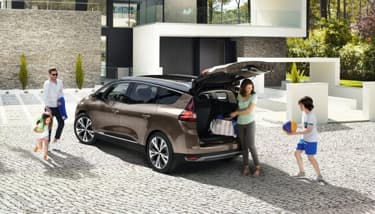 Renault Grand Scenic parked with family