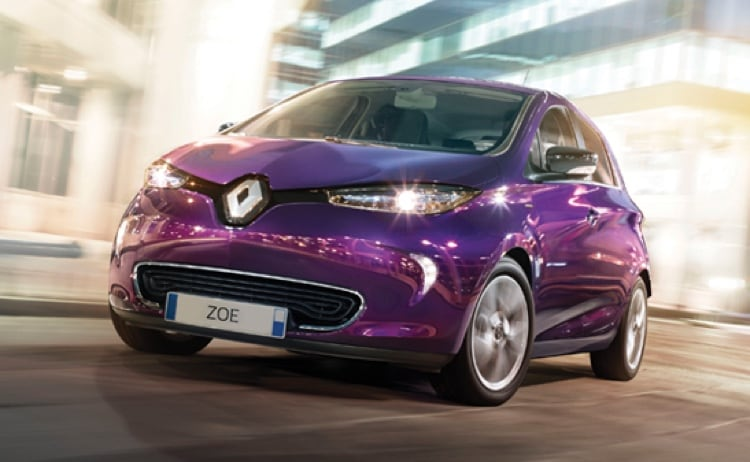 Purple Renault Zoe driving in city street