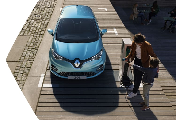 Top view of a Renault Zoe parking with father and son charging the vehicle.